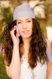 Beautiful young caucasian girl talking at the mobile phone Royalty Free Stock Image