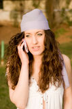 Beautiful young caucasian girl talking at the mobile phone Royalty Free Stock Photo