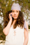 Beautiful young caucasian girl talking at the mobile phone Royalty Free Stock Photos