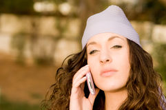 Beautiful young caucasian girl talking at the mobile phone Stock Image