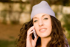 Beautiful young caucasian girl talking at the mobile phone Royalty Free Stock Photography