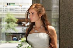 Beautiful young caucasian redhead with bouquet Royalty Free Stock Photography