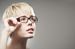 Beautiful Young Caucasian Woman Adjusting Her Glasses Stock Photos