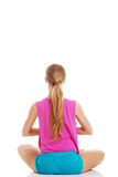 Beautiful young caucasian woman is exercising, doing yoga. Stock Image