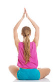 Beautiful young caucasian woman is exercising, doing yoga. Royalty Free Stock Image