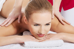Beautiful young caucasian woman lying on a massage table Stock Image