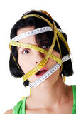 Beautiful young woman with measuring tape Royalty Free Stock Images