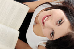 Beautiful young caucasian woman reading book Royalty Free Stock Photos