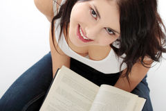Beautiful young caucasian woman reading book Stock Image