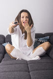 Beautiful young Caucasian woman relaxing on couch Stock Photo
