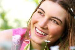 Beautiful young caucasian woman smiling with flower Royalty Free Stock Photo