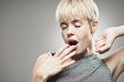 Beautiful Young Caucasian Woman Yawning Stock Photography