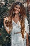 Beautiful young cheerful boho style woman outdoors stock images