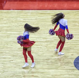 Beautiful young cheerleaders bright original show team support. Royalty Free Stock Photos