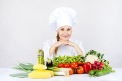 Beautiful young chef woman prepare and decorating tasty food in Royalty Free Stock Photos