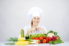 Beautiful young chef woman prepare and decorating tasty food in Royalty Free Stock Images