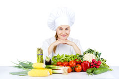 Beautiful young chef woman prepare and decorating tasty food in Stock Photo