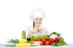 Beautiful young chef woman prepare and decorating tasty food in Royalty Free Stock Photography