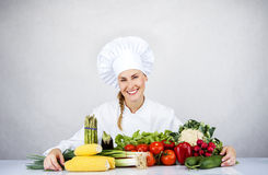 Beautiful young chef woman prepare and decorating tasty food in Stock Photography