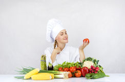 Beautiful young chef woman prepare and decorating tasty food in Stock Image