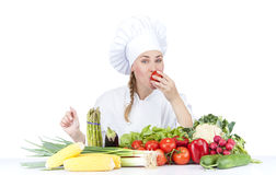 Beautiful young chef woman prepare and decorating tasty food in Royalty Free Stock Image