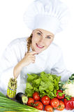 Beautiful young chef woman prepare and decorating tasty food in Stock Images