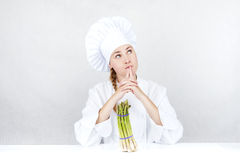 Beautiful young chef woman prepare and decorating tasty food in Stock Photos