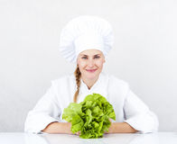 Beautiful young chef woman prepare and decorating tasty food veg Stock Image