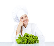 Beautiful young chef woman prepare and decorating tasty food veg Stock Images