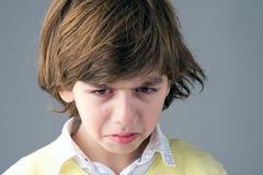Beautiful young child crying Stock Photos