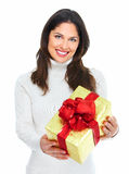 Beautiful young Christmas girl with gift. Royalty Free Stock Images