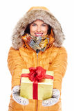 Beautiful young Christmas girl with a present. Royalty Free Stock Image