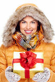 Beautiful young Christmas girl with a present. Stock Photos