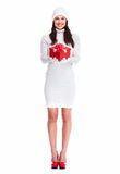 Beautiful young Christmas girl with a present. Royalty Free Stock Images