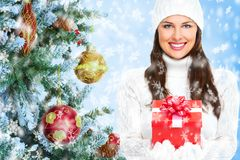 Beautiful young Christmas girl with a present. Royalty Free Stock Photo