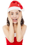 Beautiful young christmas woman making a funny expression Royalty Free Stock Image