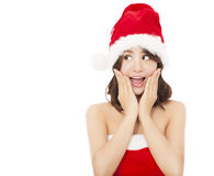 Beautiful young christmas woman making a funny expression. Over white background Royalty Free Stock Photos