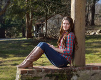 Beautiful young country girl on farm outdoors Stock Images
