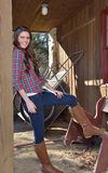 Beautiful young country girl on farm outdoors Royalty Free Stock Photo