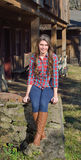 Beautiful young country girl on farm outdoors Royalty Free Stock Images