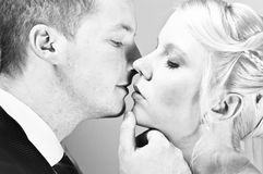 Beautiful young couple. Kissing in black and white stock images