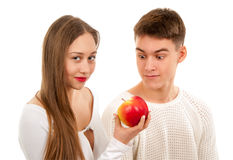 Beautiful young couple with apple Stock Photos