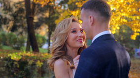 Beautiful young couple in the autumn park stock video