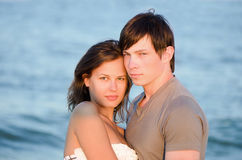 Beautiful young couple on the beach Royalty Free Stock Images