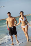 Beautiful Young Couple at Beach Stock Photography