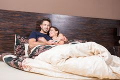 Beautiful young couple in Bed Stock Photo