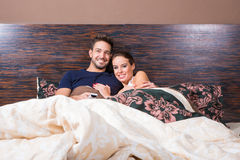 Beautiful young couple in Bed Stock Image