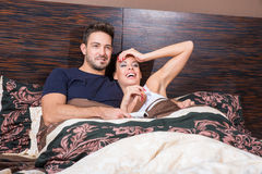 Beautiful young couple in Bed Royalty Free Stock Photos