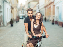 Beautiful young couple on a bicycle in the city Stock Photo