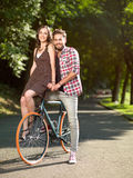Beautiful young couple on a bicycle smiling Stock Photography